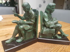 Max le Verrier - A pair of bookends - Patinated metal on marble base