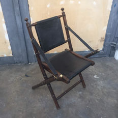 Designer unknown - officer's chair consisting of wood with leather upholstery