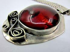 Silver hand made pendant with Amber