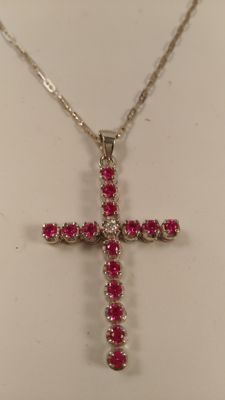 18 kt white gold crucifix with diamonds and rubies