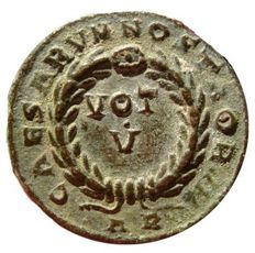 Roman Empire - Constantine II as caesar (316-337 A.D.) bronze follis (3,73. g., 17 mm). Arles mint, (A.D. 321). CAESARVM NOSTRORVM , VOT V within wreath; AR. Rare.