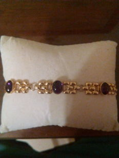 18 kt gold bracelet with purple crystals. Safety chain.  17 cm