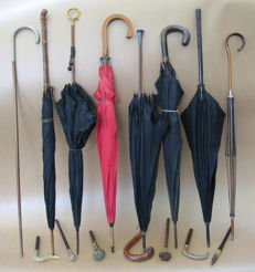 Collection of umbrellas and loose handles