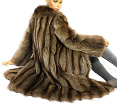 Soft, stylish fur coat made of beautiful raccoon fur coat