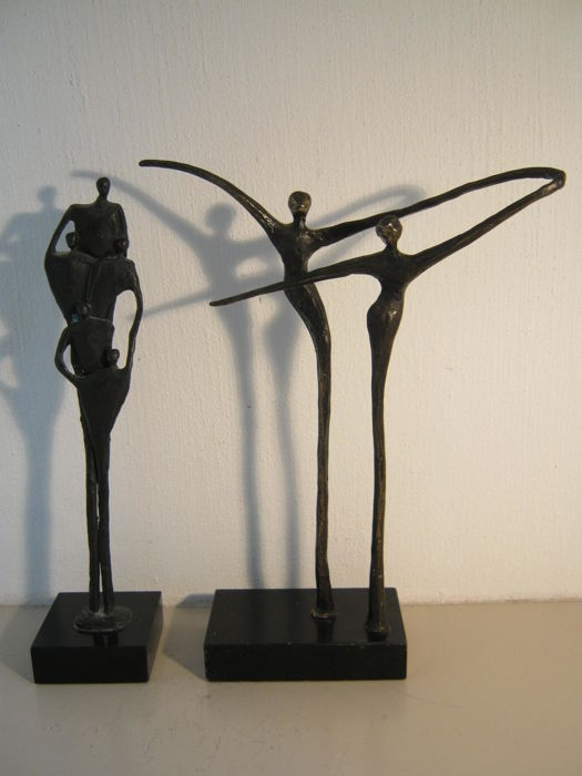 "Corry Ammerlaan van Niekerk - lot of two sculptures on a marble base - ""Working Apart Together"" (signed) & ""Verbondenheid"" (24.5 cm, tall version)"