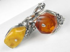 Silver ring and brooch with amber, made by hand in Germany