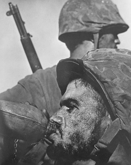 W. Eugene Smith (1918-1978) - Saipan - Soldier with canteen, 1944