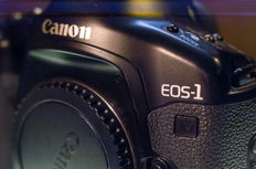 A Canon EOS 1-V with high speed booster