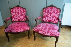 A pair of Rococo style armchairs, carved, moulded, cambered frame with floral relief - Southern Germany - 19th century