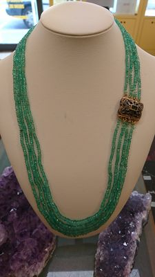 Necklace with four strands of emeralds