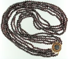 14 kt Rose gold clasp on a 5-strand garnet necklace