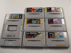 Lot of 7 Super Nes games and a gameboy player. Games like: Mario Kart, star wing, bubsy and more