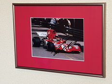 Niki Lauda - Multiple world champion Formula 1 - original autographed framed photo + COA.