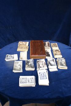 Large collection of +/-700 religious postcards from 1900 to 1950s including many cards with silver gelatin print, also there is an original photo book with old attachment from around 1875