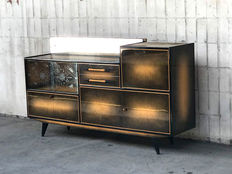 Kalwaria – a chest of drawers with a mirror and engraved windowpanes.