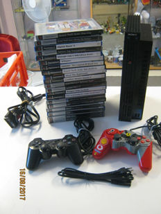 Ps2 with 2 controllers and 20 games.
