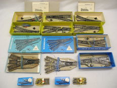 Märklin H0 - 5117/5202/5214/5121 - 10 electric switches and 2 lighted buffer blocks for M-rails [314]