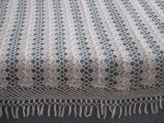 Crochet double bedspreads of white cotton, finished around with fringes.