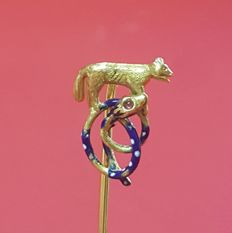 Gold pin headed by a wolf and a coiled snake made from enamel and ruby.  19th century.
