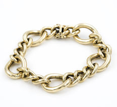 Yellow gold articulated bracelet composed of links and double safety clasp.