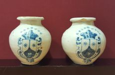 Talavera, Spain,  18th century. Pair of small glazed earthenware jars with El Carmelo coat of arms.