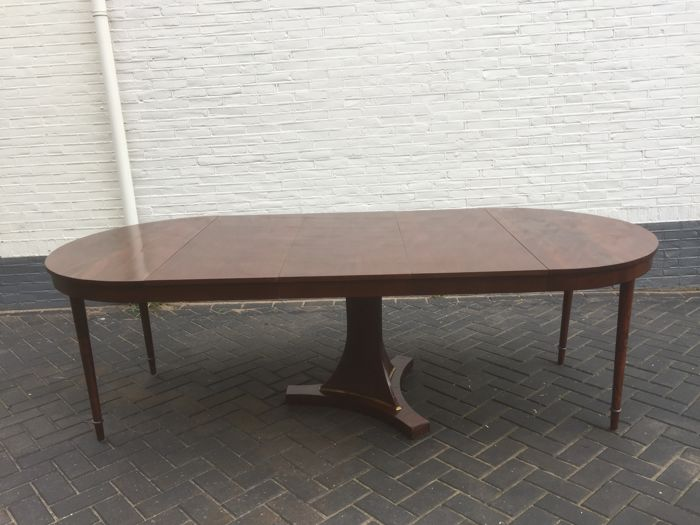An Empire mahogany extendable table with 3 connecting parts - the Netherlands - circa 1830/1840