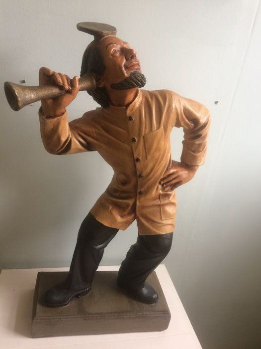 Large and cheerful statuette of a doctor