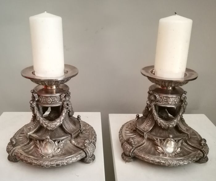 Pair of French silver candlesticks, contrast Head of Minerva