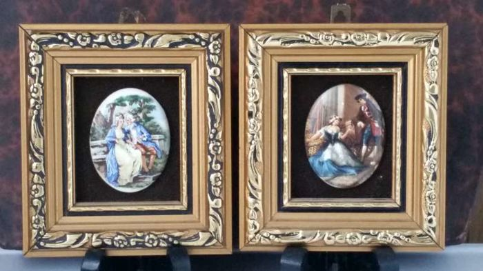 a pair of miniature paintings with a romantic scene enamel on