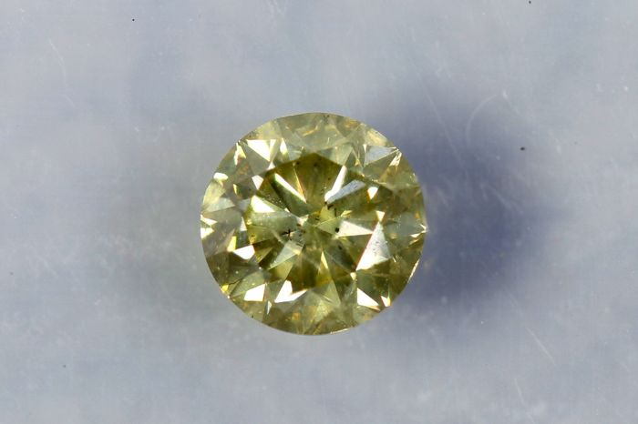 Diamant  0.50 ct - SI2 - Fancy Greenish Yellow - Zonder Reserve Prijs