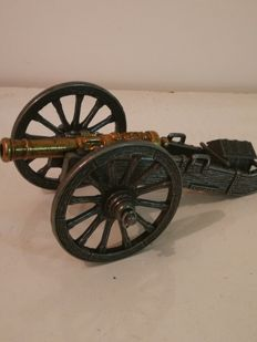 Burnished metal collectible cannon, finished with effigy