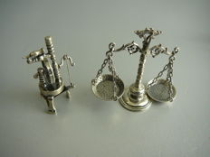 2 silver miniatures i.e. spinning wheel and scale