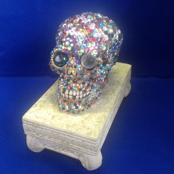 Resin skull set with Swarovski crystals.