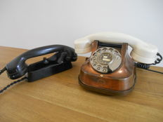 Two beautiful old telephones from bakelite and copper