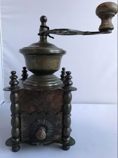 Unpolished antique copper coffee grinder from 1900.