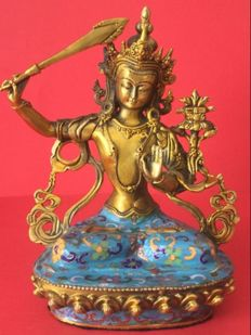 Depiction of Manjushri in cloisonné brass with enamel and an old gold patina – Nepal – late 20th century.