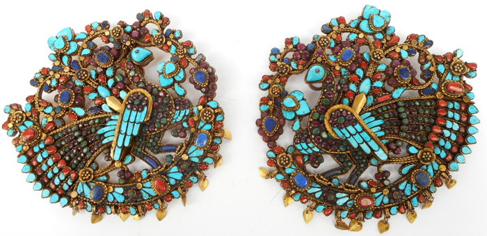 Pair of gilt-brass jeweled peacock (Mayura) ornaments paved with a mosaic of inset turquoises, corals, lapis lazulis, rubies and emeralds - Nepal - 1950-ies