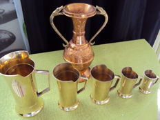 Lot of 5 measuring cups and a copper vase