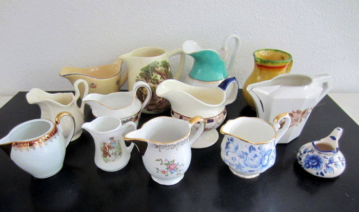 Collection of milk jugs made of porcelain and pottery