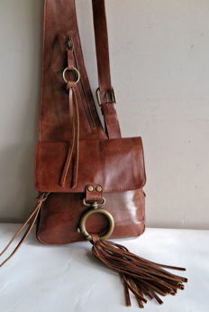 Vintage handmade shoulder- / bag pack in western style with leather tassels