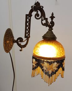Wall lamp of amber glass with glass hangers, Art Deco style, France, 20th century.