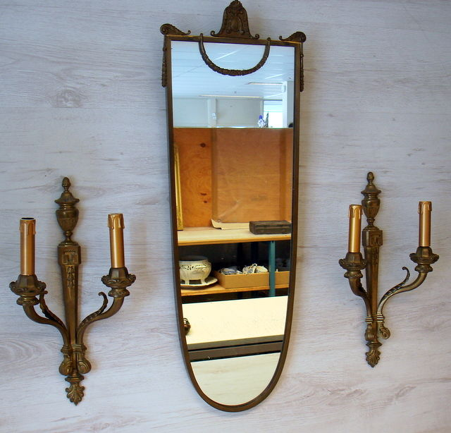 Wall mirror in bronze frame with 2 bronze wall lights in Louis Quinze style