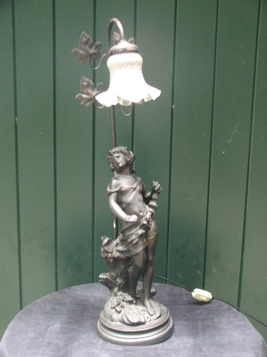 Cast iron standing youth - lamp