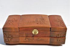 Large wooden jewellery box with Oriental decorations.