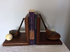 2 Bookends, St. Andrews, with antique Golf clubs and vintage golf balls.
