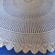 Round crochet tablecloth.