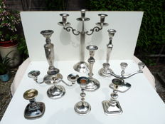 Nine beautiful silver-plated antique candlesticks.