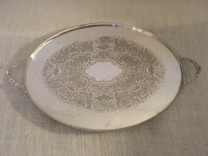 "Vintage silver plated oval shape embossed decorated design centre tray ,double handles and victorian style  four claw feet  first half of 19th century ""ENGLAND """