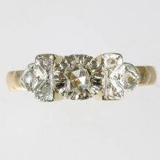 Belle epoque engagement ring with one rose cut diamond and six senailles