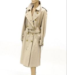 Thomas Burberry - Westminster cut trench coat. This timeless piece has a modern cut, ideal for wearing over tailored clothing.